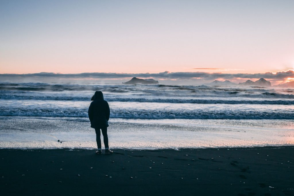 Person on beach at sunset